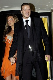 Here he's doing the suit and scarf thing.. The suit is Ralph Lauren.